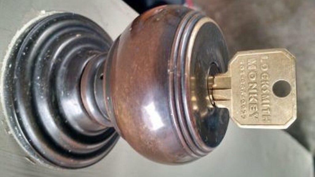 key inside a brown home lock rekeying